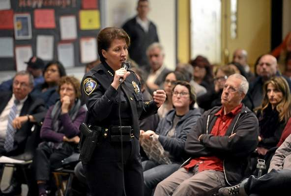 Seaside Police Chief Vicki Myers address a community meeting with the help of a Spanish Interpreter from Translation By Design